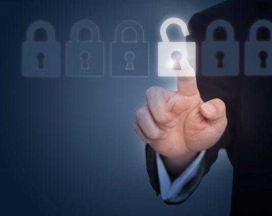 businessman-unlocking-lock-touch-screen